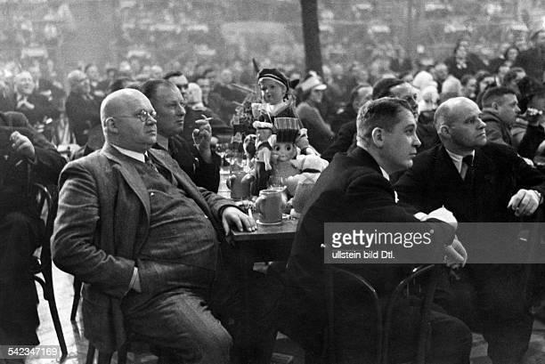 Germany, Bock Beer Party in the Hasenheide in Berlin, men watching the programm- Photographer: Herbert Hoffmann- Published by: 'Hier Berlin'...