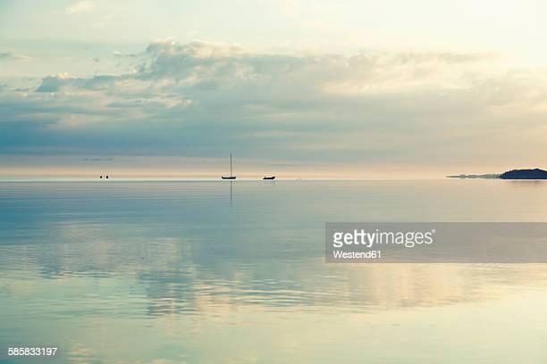 Germany, Boltenhagen, smooth sea in early morning light