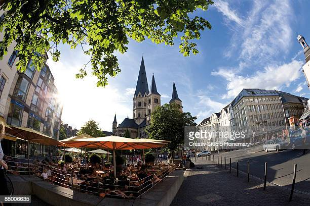 Germany, Bonn, Cathedral, sidewalkk cafe in foreground