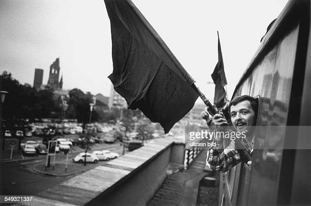 Germany Bonn May 1968 'March to Bonn' demonstration against the German Emergency Acts man with a black flag in a special train going from Berlin to...