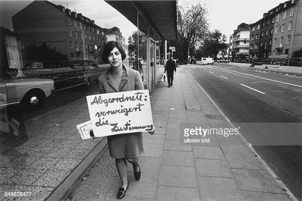 Germany Bonn May 1968 'March to Bonn' demonstration against the German Emergency Acts young woman demonstrating with the slogan 'Member of Parliament...