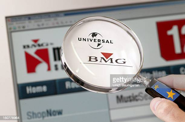 Germany BONN Universal Music and BMG logos seen through an amplifying glass Symbol amalgamation of Universal Music and BMG[M]