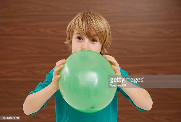 germany, boy inflatiing balloon - inflating stock pictures, royalty-free photos & images