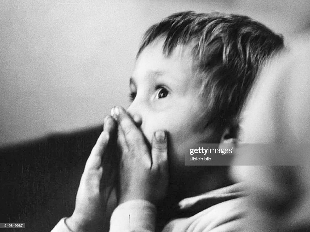 Germany, boy in childrens theater in the Reichskabarett in Berlin, in 1972 becomming the Grips-Theater, watching a play. : News Photo