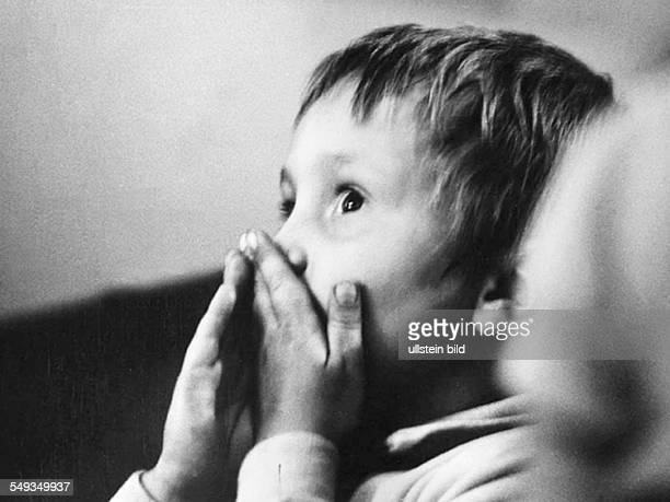 Germany boy spectator in childrens theater in the Reichskabarett in Berlin in 1972 becomming the GripsTheater watching a play