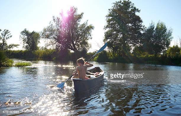Germany, Brandenburg, Boy paddeling on Spree river