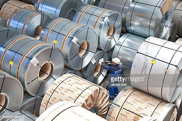 Germany Brandenburg Eisenhuettenstadt A worker is scanning freight documents of finished rolls of ribbon steel at the steel works ArcelorMittal