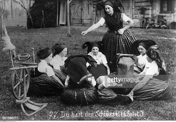 Germany Brandenburg Province Spreewald area Sorbian girls play a game 'Who has the key' A key is secretly passed from one girl to the next by hiding...