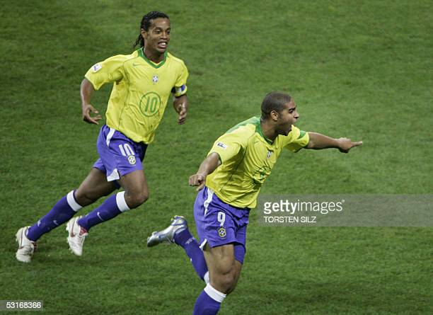 Brazilian forward Adriano celebrates with Midfielder Ronaldinho after he scored the opening goal during the final match of the 2005 FIFA...