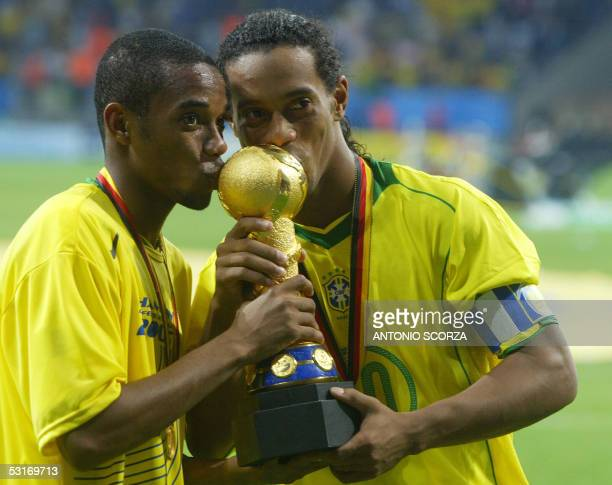 Brazilian forward Robinho and captain Ronaldinho kiss the trophy at the end of the 2005 FIFA Confederations Cup football final Brazil vs Argentina at...