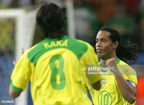 Brazilian midfielder and captain Ronaldinho celebrates with midfielder Kaka after scoring a third goal for his team during the 2005 FIFA...