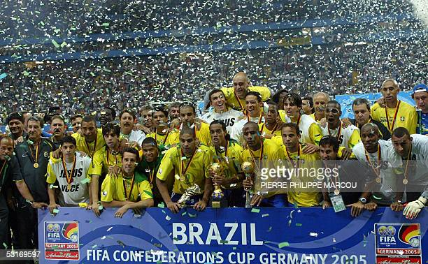 Brazilian midfielder and captain Ronaldinho holds the throphy surrounded by teammates at the end of the 2005 FIFA Confederations Cup football final...