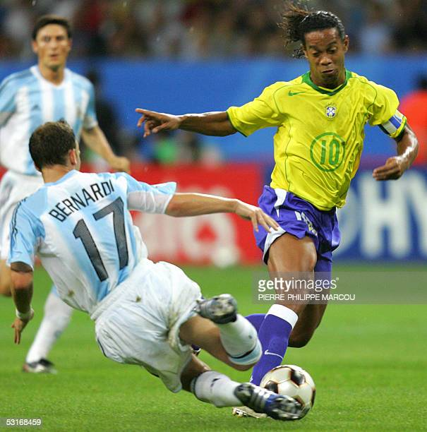 Brazilian midfielder and captain Ronaldinho vies with Argentine midfielder Lucas Bernardi during the 2005 FIFA Confederations Cup football final...