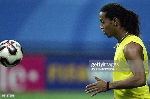 Brazilian midfielder and captain Ronaldinho warms up prior to the 2005 FIFA Confederations Cup football final Brazil vs Argentina at the Waldstadion...