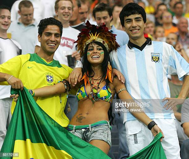 Brazilian supporters cheer with an Argentine supporter during the 2005 FIFA Confederations Cup football final Brazil vs Argentina at the Waldstadion...