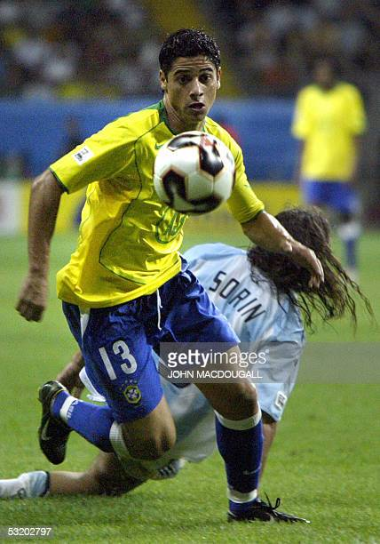 Germany: Brazil's defender Cicinho sprints with the ball during the 2005 FIFA Confederations Cup football final Brazil vs Argentina at the...
