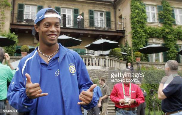 Brazil's national football team striker Ronaldinho Gaucho poses for photographers as his team walks outside the hotel 14 June 2005 in a morning off...