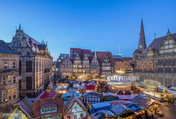germany, bremen, christmas market on market square in the evening seen from above - bremen stock pictures, royalty-free photos & images