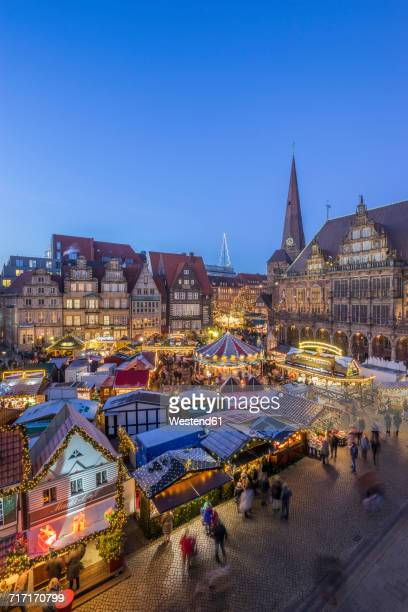 Germany, Bremen, Christmas market on market square in the evening seen from above