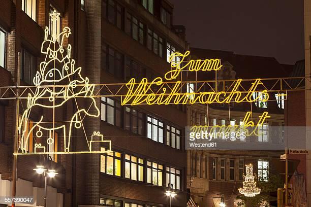 Germany, Bremen, Illuminated Christmas market advertising