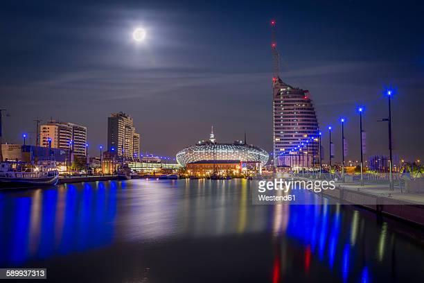 Germany, Bremerhaven, Klimahaus and Atlantic Hotel Sail City at night