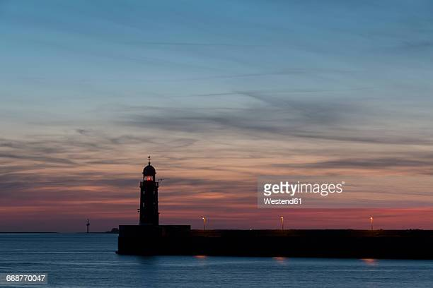 Germany, Bremerhaven, Weser with lighthouse at sunset
