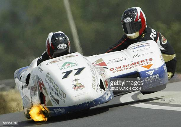 British racing brothers Tim and Tristan Reeves compete in the fourth heat of the Sidecar World Cup on 10 July 2005 in Schleiz eastern Germany The...