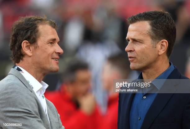 Germany business manager Oliver Bierhoff and former Germany goalkeeper Jens Lehmann pictured before the World Cup qualifier Group C soccer match...