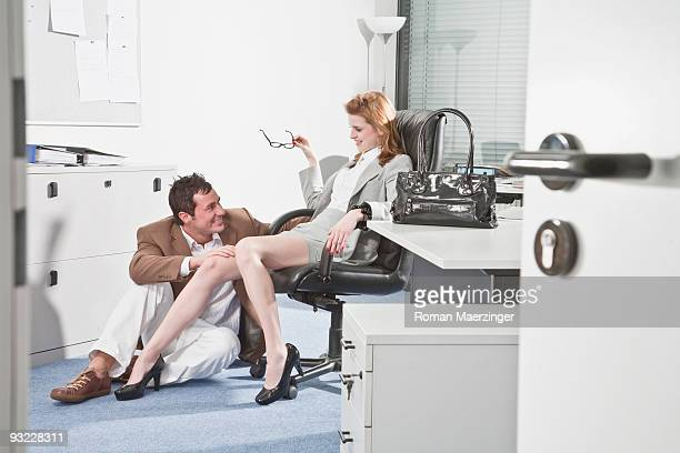 germany, business people in office, business man touching woman's knee - women dominating men stock photos and pictures
