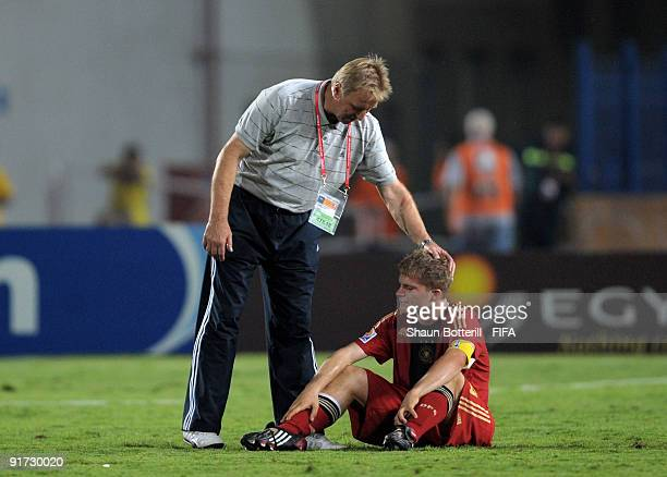 Germany captain Florian Jungwirth is consoled by coach Horst Hrubesch at the end of the FIFA U20 World Cup Quarter Final match between Brazil and...