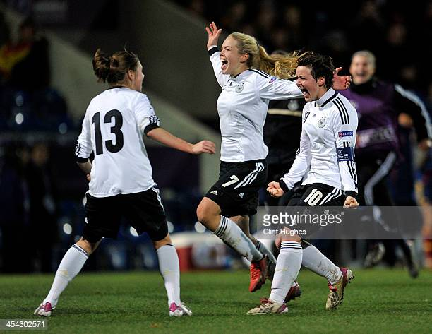 Germany captain Jasmin Sehan and Nina Ehegotz celebrate their victory with Isabella Hartig during the UEFA European Women's Under 17 Championship...