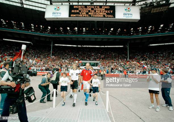 Germany captain Jurgen Klinsmann and the Czech Republic captain MIroslav Kadlec lead out their teams prior to the start of the UEFA Euro96 final at...