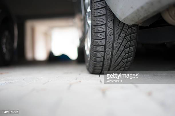 Germany, Car at underground car park, detail of tire