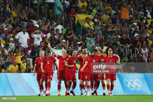 Germany celebrate after an own goal by Linda Sembrant of Sweden puts them 0-2 into the lead during the Women's Olympic Gold Medal match between...