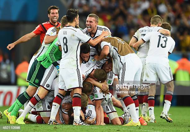 Germany celebrate defeating Argentina 10 in extra time during the 2014 FIFA World Cup Brazil Final match between Germany and Argentina at Maracana on...