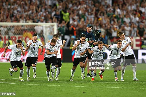 Germany celebrate following the penalty shoot out during the UEFA Euro 2016 Quarter Final match between Germany and Italy at Nouveau Stade de...
