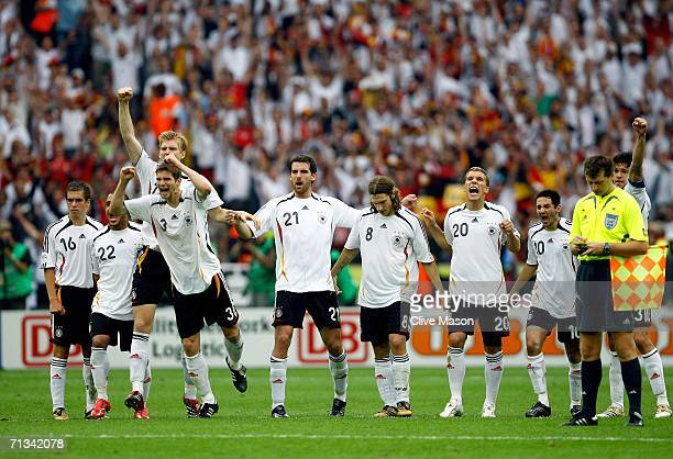Germany celebrate following their team's victory in a penalty shootout at the end of the FIFA World Cup Germany 2006 Quarterfinal match between...