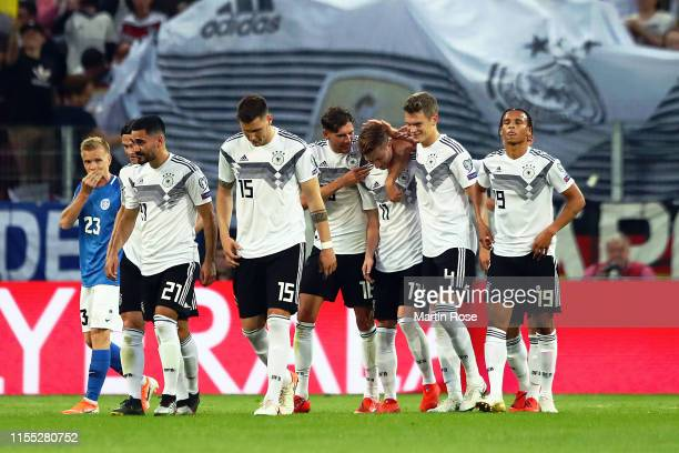 Germany celebrate their 5th goal scored by Marco Reus during the UEFA Euro 2020 Qualifier match between Germany and Estonia at Opel Arena on June 11...
