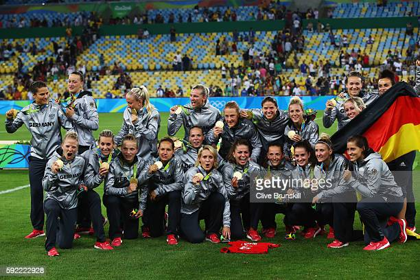 Germany celebrate with their gold medals following victory during the Women's Olympic Gold Medal match between Sweden and Germany at Maracana Stadium...