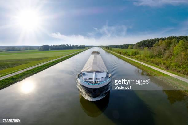 germany, central franconia, cargo ship on rhine main danube canal - kanal stock-fotos und bilder