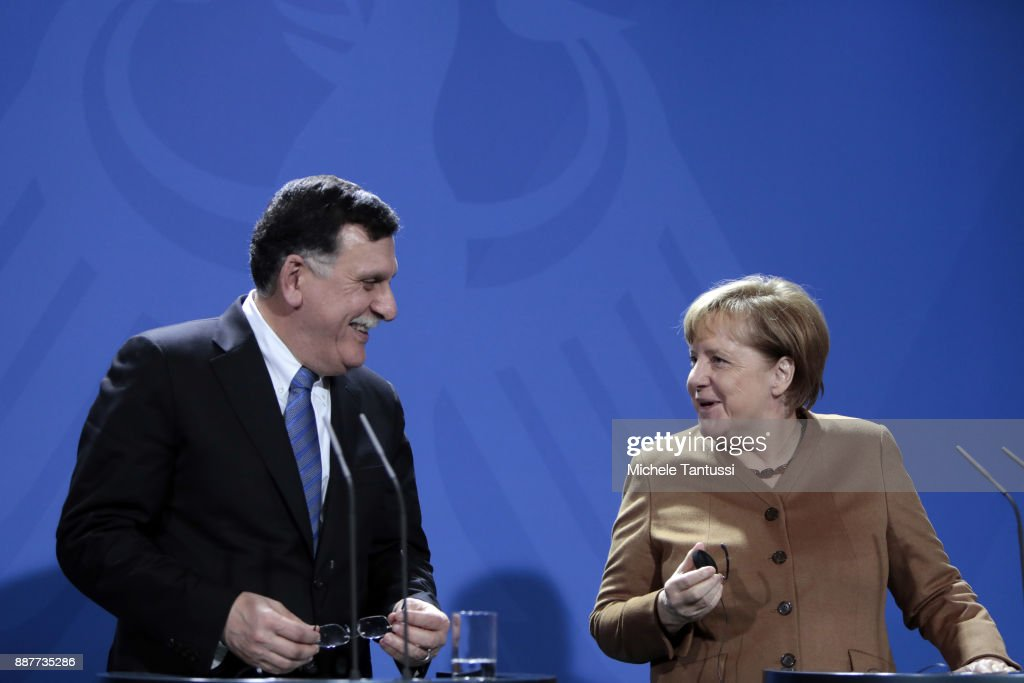 Germany Chancellor Angela Merkel and Chairman of the Presidential Council of Libya and prime minister Fayez Mustafa al-Sarraj adress the media during a press conference ahead of their meeting in the German Chancellery on December 7, 2017 in Berlin, Germany. The Libyan leader meets Merkel to discuss the political situation of both states relationship, focusing on finding a better way to solve the refugees issue.