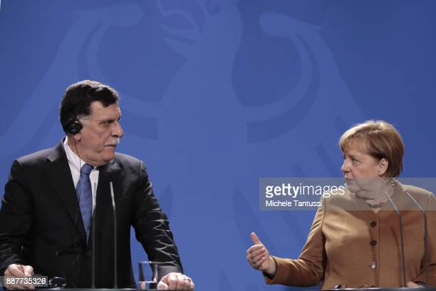 Germany Chancellor Angela Merkel and Chairman of the Presidential Council of Libya and prime minister Fayez Mustafa al-Sarraj adress the media during...