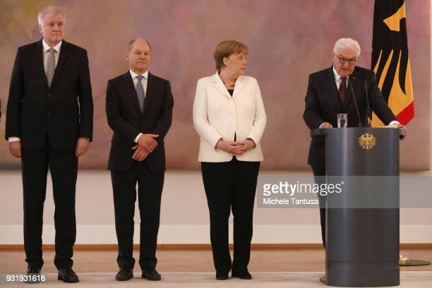 Germany Chancellor Angela Merkel listens to Germany President FrankWalter Steinmeier near finance Ministry and vice Chancellor Olaf Scholz and...