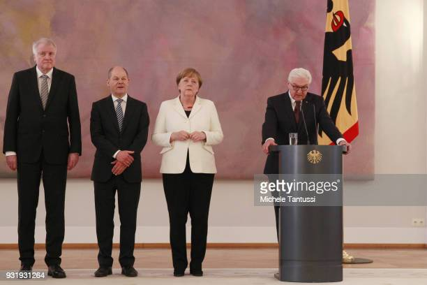 Germany Chancellor Angela Merkel listens to Germany President FrankWalter Steinmeier between finance Ministry and vice Chancellor Olaf Scholz and...