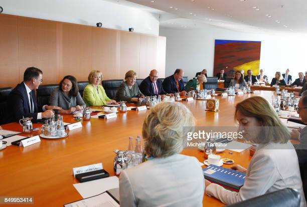 Germany Chancellor Angela Merkel sit between ministers as they arrive for the last weekly government cabinet meeting before German federal elections...