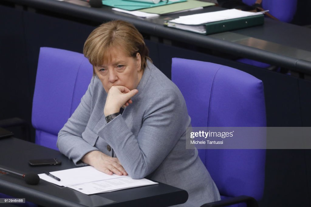 Germany Chancellor Angela Merkel sits in the Plenary Hall of the Parliament or Bundestag during the debate on Refugee rights to Family conjunction on February 1, 2018 in Berlin, Germany. The German Christian Democrats (CDU/CSU) and the German Social Democrats (SPD), in their ongoing coalition negotiations, agreed yesterday on a compromise that starting August 1 the number of family members allowed to immigrate will be capped at 1,000 per month.