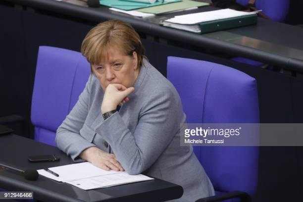 Germany Chancellor Angela Merkel sits in the Plenary Hall of the Parliament or Bundestag during the debate on Refugee rights to Family conjunction on...