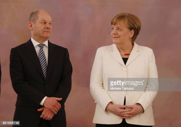 Germany Chancellor Angela Merkel stands beside finance Ministry and vice Chancellor Olaf Scholz as she takes her oath to serve as Chancellor...