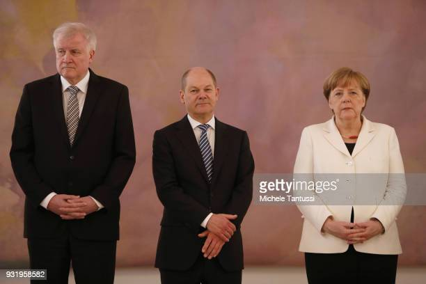 Germany Chancellor Angela Merkel stands near finance Ministry and vice Chancellor Olaf Scholz and Interior Ministry Horst Seehofer as she takes her...