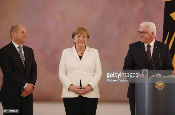 Germany Chancellor Angela Merkel stands near finance Ministry and vice Chancellor Olaf Scholz and IGerman President FrankWalter Steinmeier as she...
